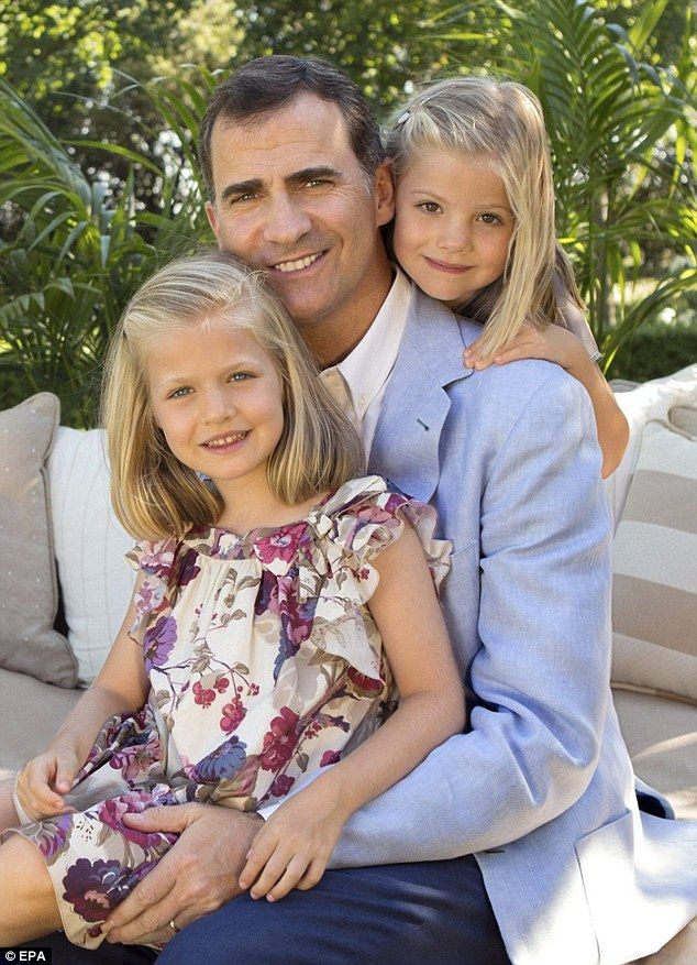 Official portrait: Released by the Spanish Royal Household today, this touching photo shows Crown Prince Felipe (C) posing for a picture with his daughters, Princesses Leonor (L) and Sofia (R), in Madrid, Spain