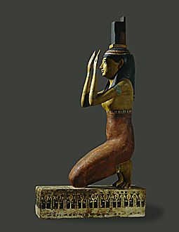 PTOLEMAIC PERIOD, EGYPT STATUE 4TH BCE  The Goddess Isis lamenting the death of her husband Osiris.She carries her iconographic hieroglyph on her head. Painted wood