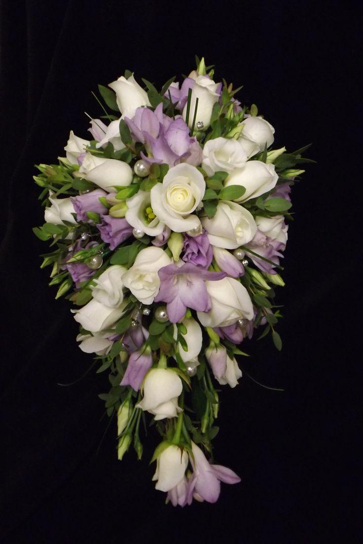 roses, freesias and lisianthus shower bouquet www.weddingflowersbylaura.com