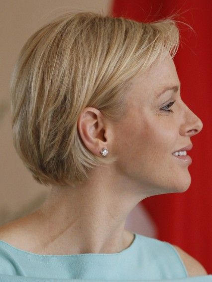 Charlene Wittstock Short Haircut - The light blonde hair is layered throughout the sides and front to lighten the length and encourage soft movement to create a natural look and feel