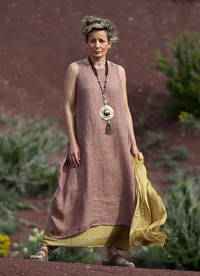 Rosewood color linen gauze tunic with golden shades and antique gold shantung silk sarouel skirt. Necklace: hand hammered brass pendant wit...