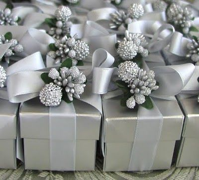 Wrap your wedding favours up like little Christmas presents and finish with a bow and festive trim.