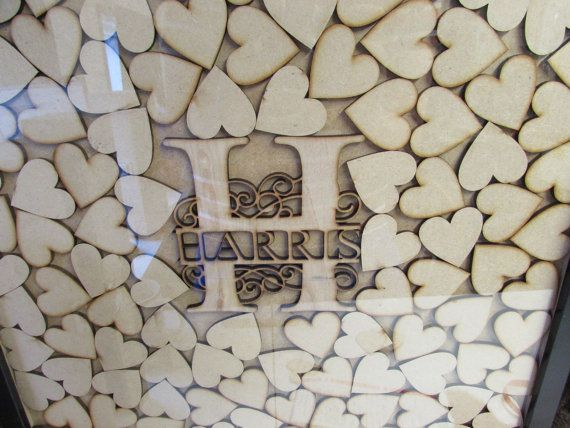 Another custom design by Senaxus Laser craft.   Personalised wooden heart drop top, drop box guestbook with 150 hearts to sign and 1 large Monogram