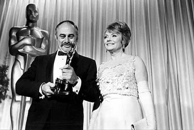 "Martin Balsam looks at his Oscar as he poses with actress Lila Kedrova, who presented the statuette, at the Academy Awards at the Santa Monica Civic Auditorium, Ca., April 18, 1966. Balsam won best supporting actor for his role in ""A Thousand Clowns."" (AP Photo) / SF"