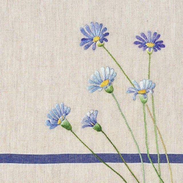 Floral embroidery on tea towel