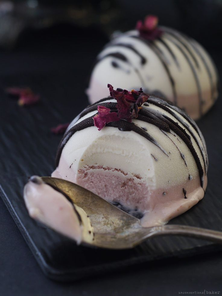 Neapolitan Ice Cream Bombs: These strawberry vanilla chocolate drizzled ice cream bombs are a raw, vegan, and refined sugar-free spin on the Neapolitan classic.