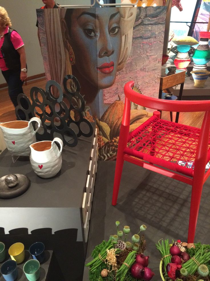 """The coherence between the Tretchikoff """"Fruits of Bali"""" and the contemporary pink chair at Make It New emphasise how versatile the Tretchikoff wallpaper is!"""