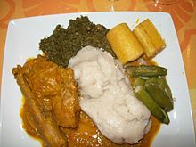 Moamba de galinha - National dish of Angola. Chicken cooked in palm paste, okra, garlic, palm oil hash or sauce served with rice and fungee.