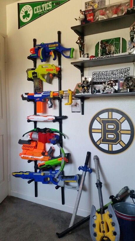 Pvc pipe nerf gun holder ! Bought 2 , 3/4 pvc pipes, 16 T fittings and 16 caps cut 16 8in and 16 4in put them together and POW ! Spray painted them black bought some brackets and thats it ! Took about 3 hours from start to finish!