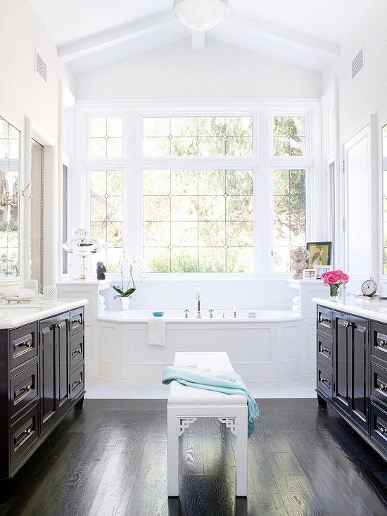 Fabulous contrast between the dark floors and cabinets with the white tub and subtle wallpaper! Beautiful. #Bathroom #Sink #Shower #Irvine #RealEstate ༺༺ ❤ ℭƘ ༻༻