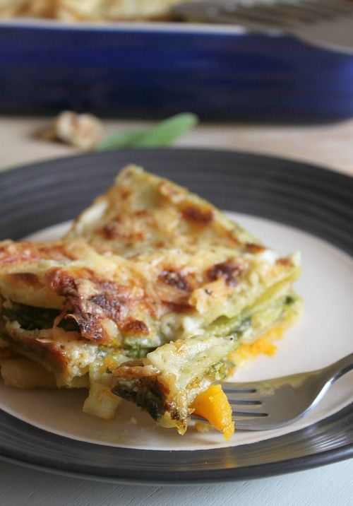 Cheesy roasted butternut squash lasagna with spinach walnut and pesto