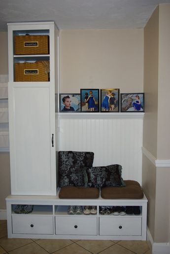 Ikea TV stand with legs cut off and single wardrobe above plus wainscoting. Very clever.