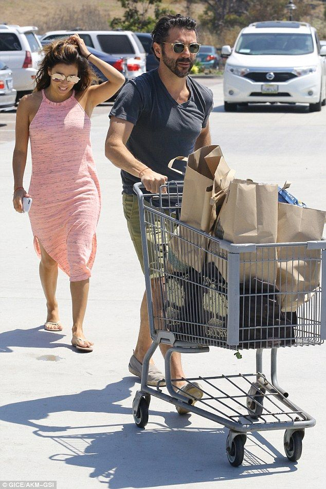 Upping the sizzle factor: Eva Longoria poured her shapely body into a sheer pink sundress as she went grocery shopping with husbandJosé Baston in Malibu on Sunday