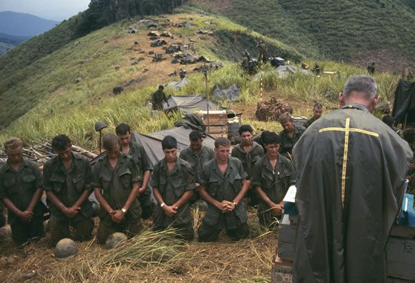Soldiers Pray with Army Chaplain: Soldiers pray with the army chaplain on the front lines of the Vietnam War. (Photo Credit: Europress/Sygma...