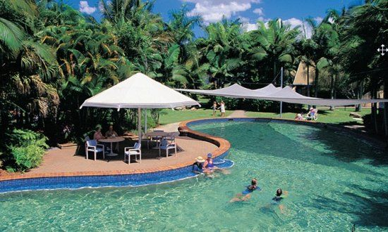 Garden pool with waterslide » Cairns Coconut Holiday Resort