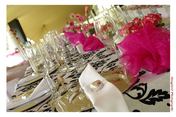 The dramatic bridal table with a white tablecloth embossed with black velvet and cerise pink linen napkins www.iceevents.co.za