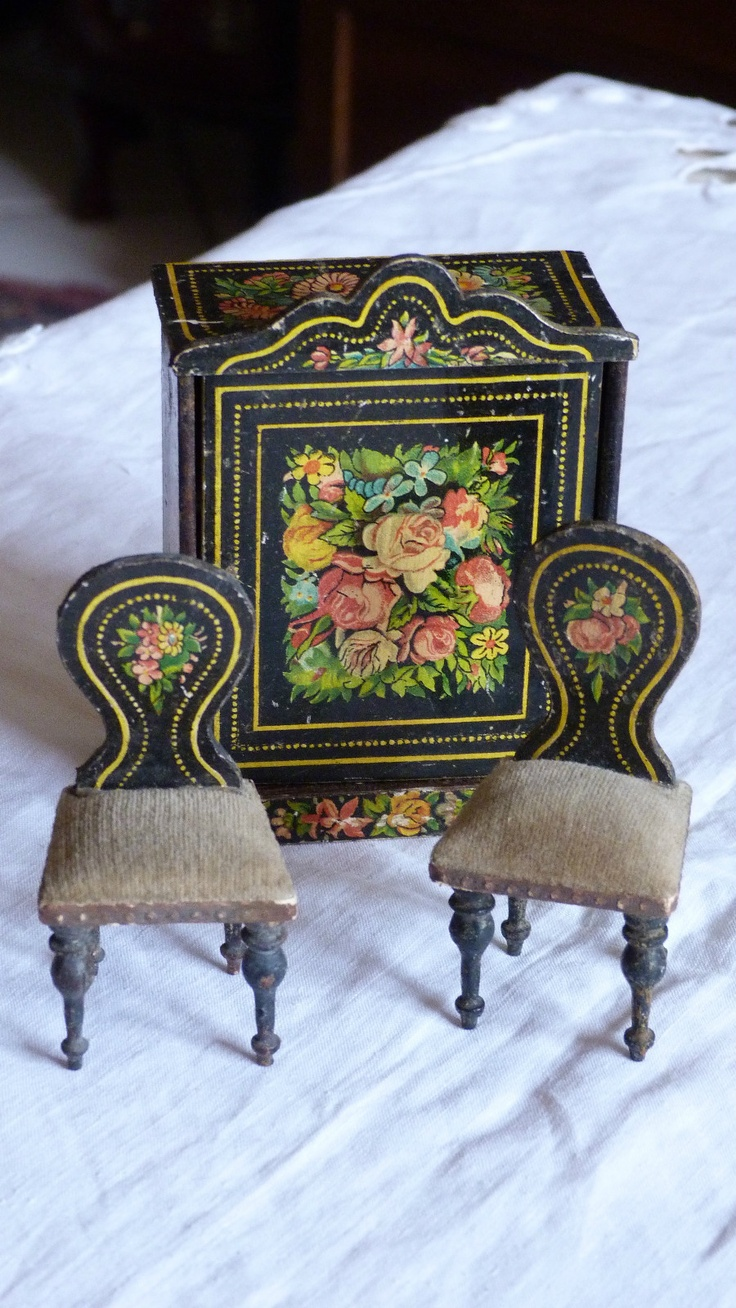Late 19th c. German lithographed dollhouse cabinet and chairs.  Yes please...