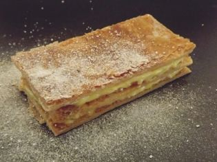 The mandarin and mastic sauce add intense flavor and color to the classic millefeuille.