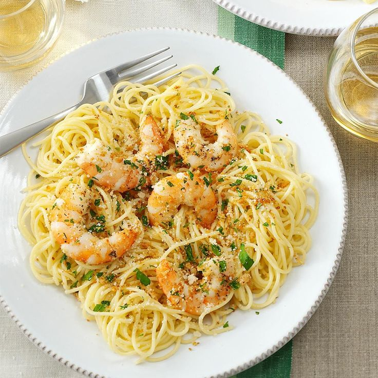 Shrimp Scampi Recipe -This shrimp scampi recipe looks like you fussed, but it's easy to prepare. Lemon and herbs enhance the shrimp, and bread crumbs add a pleasing crunch. Served over pasta, this main dish is pretty enough for company. —Lori Packer, Omaha, Nebraska