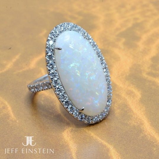 The beauty of opal is perfectly showcased in this 18ct white gold and diamond setting  jeffeinsteinjewellery#jeffeinsteinjewellery #doublebay #sydney #opal #diamondring #picoftheday #luxury #handmadejewellery #whitegold #style #finejewellery