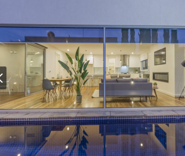 Floor to ceiling windows overlooking the pool. This is the look we want for the area with the inclusion of a sliding door (as per previous picture) to enable exit/ entry functionality