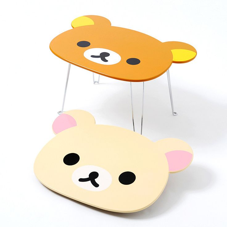 These Rilakkuma and Korilakkuma tables are convenient and cute! They are small enough in size that they can be easily carried, yet still large enough to be used as a table. Their metal legs are strong and simply fold against the back of the table for easy storage. Makes a great addition to any kawaii room and is an excellent display table for San-X collectables!