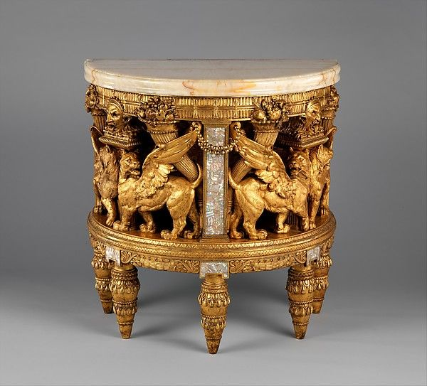 "Herter Brothers (1864–1906). Console from the drawing room of the William H. Vanderbilt House, 1879-82. The Metropolitan Museum of Art, New York. Gift of Jan and Warren Adelson, 2013 (2013.956a, b) | This work is featured in the ""Artistic Furniture of the Gilded Age"" exhibition, on view through May 1, 2016. #GildedAgeFurniture"
