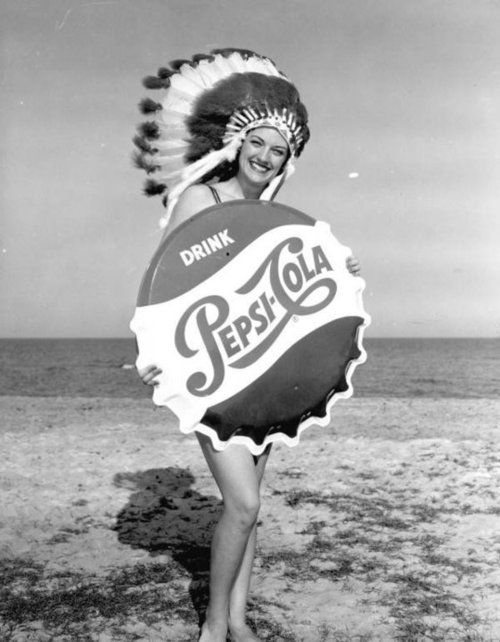 1950s Pepsi Ad - WTF is up with the headdress? She is clearly not Native American - is it meant to invoke an image of Pepsi as truly American?