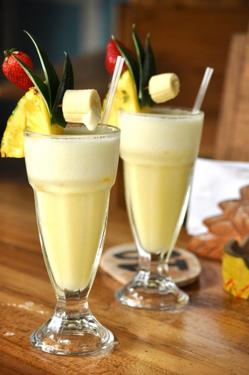 Ingredients:  3 ounces light rum  4 Tbsp coconut cream  1 Tbsp milk  1/2 cup fresh pineapple (crushed)  3/4 cup frozen fresh pineapple (crushed)  1 cup crushed ice  Combine all ingredients in a blender and mix at high speed until smooth. Pour into tall glasses and garnish with fresh pineapple wedges. Serves 2.