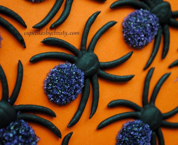 Royal icing spiders with purple dusting sugar.