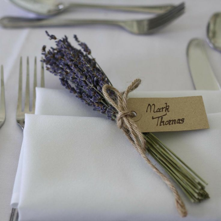 like this idea for place cards but perhaps instead of lavender something that suits our colour scheme.