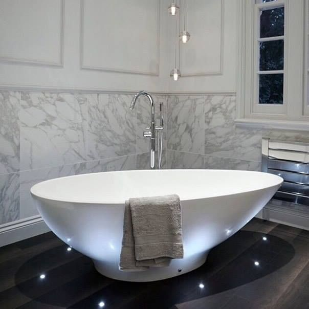 2015 Best of Bathroom design...amazing free standing tub with amazingly thoughtful floor lighting...