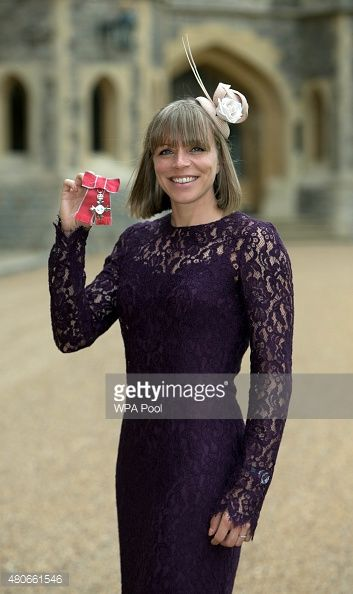 Kate Richardson-Walsh, captain of England and Great Britain women's hockey teams, poses after receiving her MBE (Member of the Order of the British Empire) award for her services to hockey, from the Princess Royal, at an investiture ceremony on JuLY 14, 2015 at Windsor Castle, England.