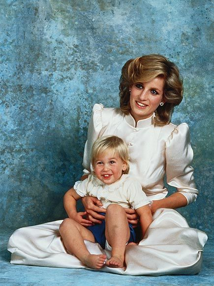 MUMMY'S BOY  Two years old and towheaded, William takes a seat on his mother's lap for a portrait session in May 1984.