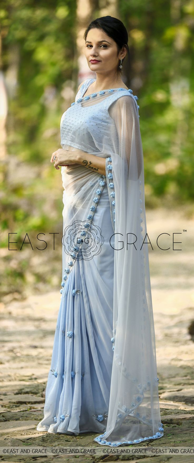 PRICE INR 7,956; US$ 120.55 To buy click here https://goo.gl/Ypc5yw Featuring the Moonlight saree in powder blue, flat pure silk chiffon with charming ribbonwork roses, that make for nothing but an ethereal, special-occasion dream. The net pallu is decorated with roses along the edges with artful detailing. It comes with an aptly complementing blouse material dotted throughout for a subtle sparkle, almost in a glitzy ode to the moonlight filled with ribbonwork roses. Reach…
