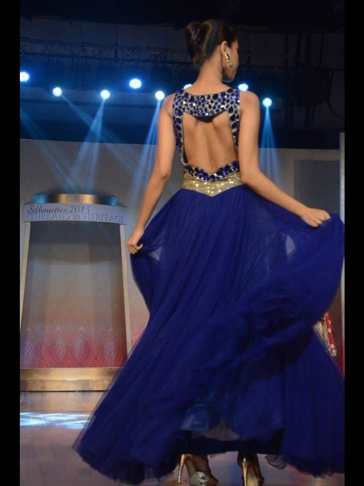 A party gown on net woth sequence and stones only at manish reshamwala fashion studio,9879568040