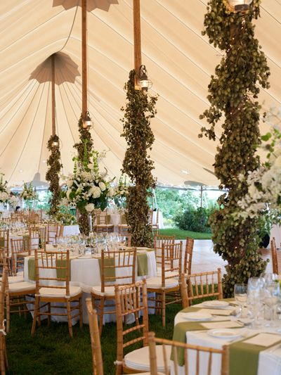 Fun idea: wrap the columns of your venue in strings of lights, greenery or colorful fabric // Photo: Blonde Tulip Photograph