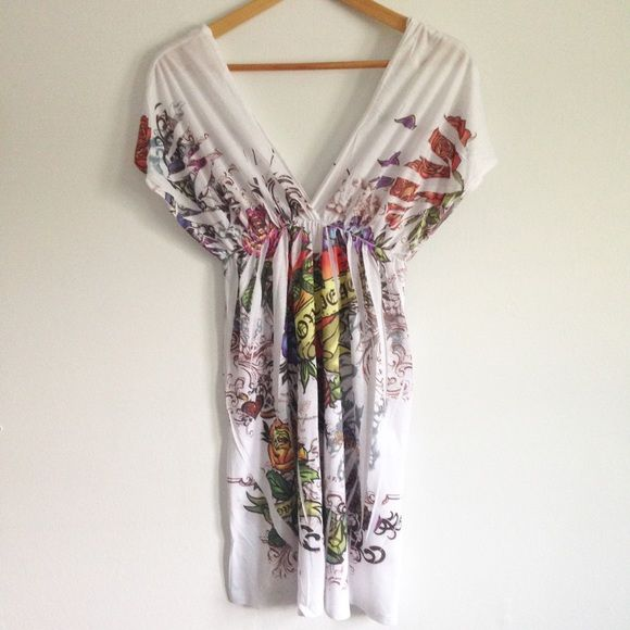 ☀️$5 SALE☀️White Festival Deep V-Neck Dress Never worn! White dress with multi-color florals and prints throughout. V-neck front and back. Relaxed fit. Size small. Dresses
