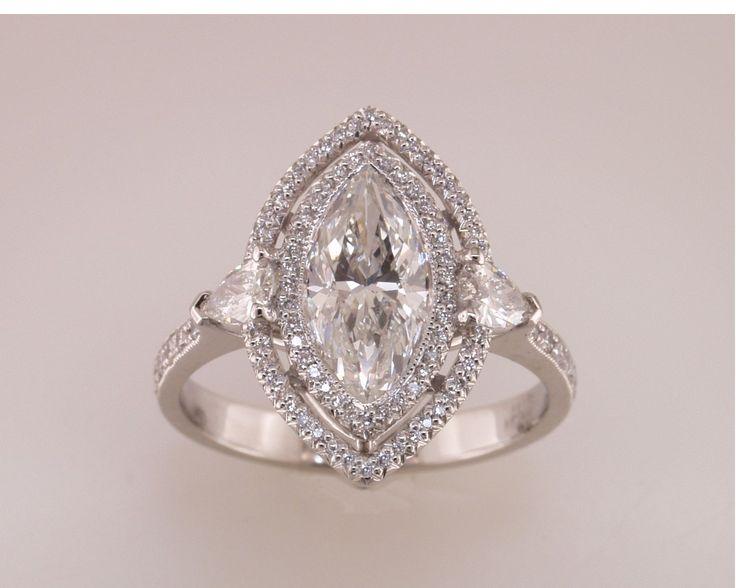 Marquise cut diamond with double diamond halo.