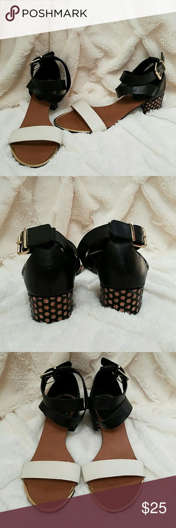Dolce Vita Heeled Sandals Black and cream heeled sandals. Polka dot heel. Gold hardware. A little worn on the bottom. Dolce Vita Shoes Sandals