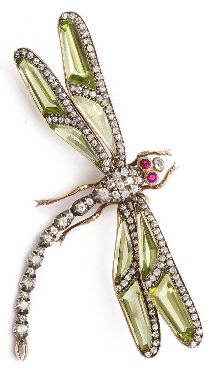 An Antique Diamond and Peridot Dragonfly Pin, English, circa 1890. Designed as a dragonfly with a diamond body, with peridot and diamond wings, en tremblant, set in silver and gold, 2 3/4 inches wide. #antique #brooch