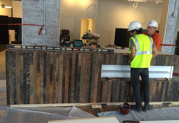 Reclaimed hardwood floors from the old Sears building will greet you when you first walk into BINDERS Ponce City Market. Here it's used to cover the cash wrap - beautiful!