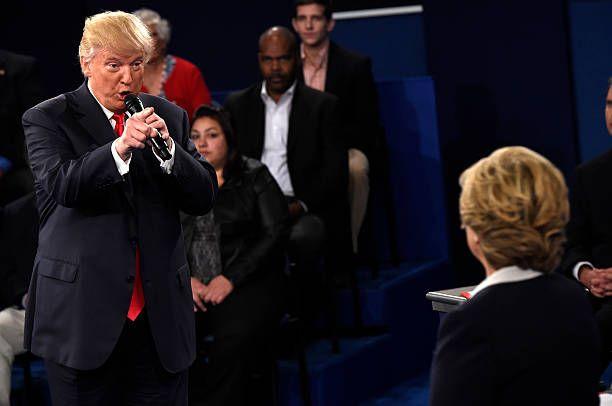 Democratic Presidential nominee Hillary Clinton and Republican Presidential nominee Donald Trump participate a town hall debate against Republican...