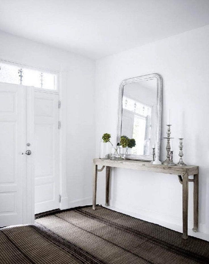Simple, but interesting entryway console with mirror/ very close too wall