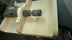 I made an adjustable table for my drill. The drill has a spindle sander attached and now it can be used as a thickness sander.