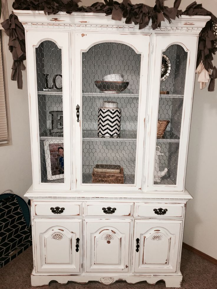 Broyhill China cabinet hutch given a chalk painted shabby chic update. Chicken wire in place of glass, gray & white tones, light distressing.