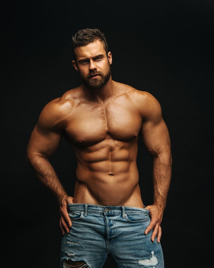 Studio portrait of handsome muscular shirtless young man