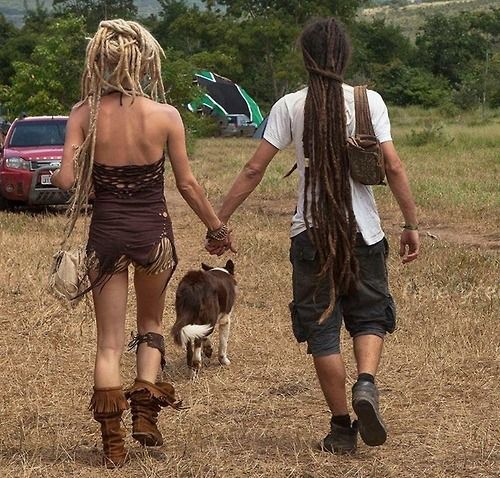 Irie Couple With Lengthy Locs Holding Hands At A Festival