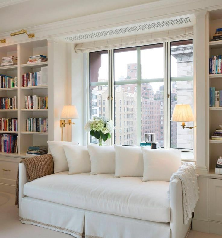 Neutral Nook, Wall Lamps, Bookshelves, White Sofa Good As For A Spare Room  / Sofa Bed :)
