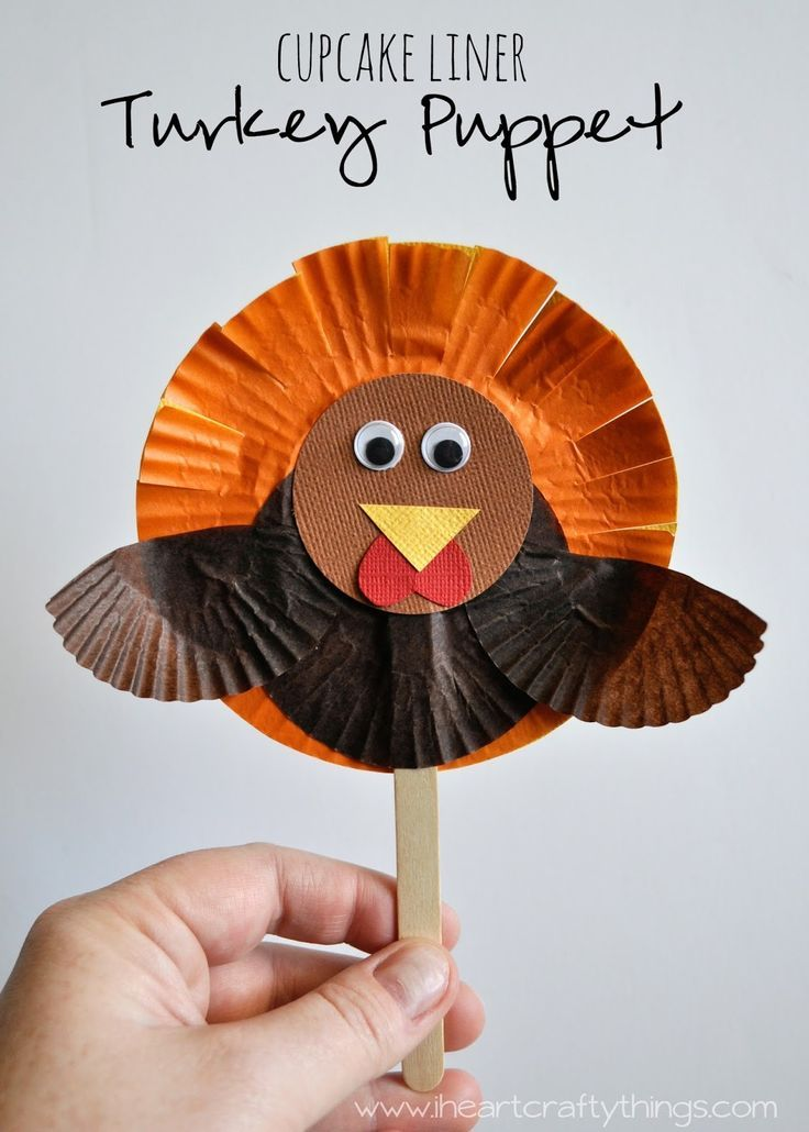 Cupcake Liner Turkey Puppet Craft for Kids. A great Thanksgiving Kids Craft that kids can play with after making it.